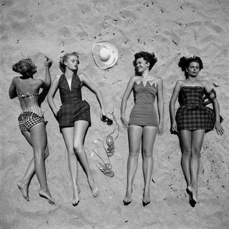 nina-leen-four-models-showing-off-the-latest-bathing-suit-fashions-while-lying-on-a-sandy-florida-beach